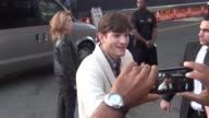 Ashton Kutcher greets fans outside the Jobs Premiere at Regal Cinemas in Los Angeles at Celebrity Sightings in Los Angeles Ashton Kutcher greets fans...