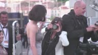 Asia Argento gives her love to the crowd at le Palais des Festivals in Cannes before the closing ceremony diner 'L'amour c'est l'infini mis à la...