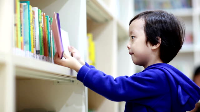 Asia Children reading in the library