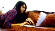 asia women lying use computer