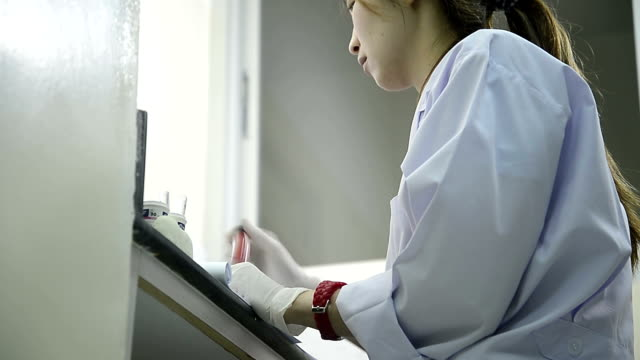 asia women medical technology doing research in laboratory