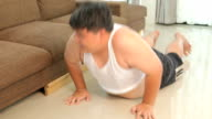 Asian fat Man exercising push up in home