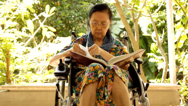 Asian adult woman sitting on her wheelchair