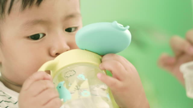 Asian Baby Drinking Water