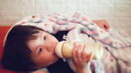 CU : Asian Baby Girl Eating Milk With A Bottle