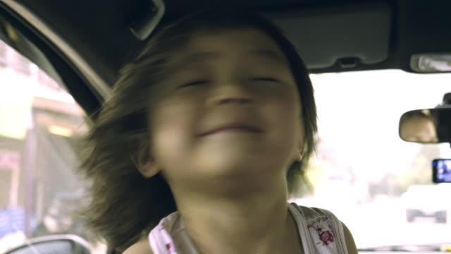Asian Baby Girl Tossing Hair
