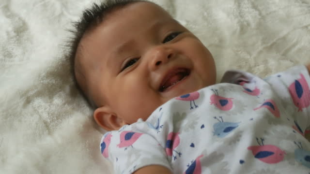 Asian baby smiling