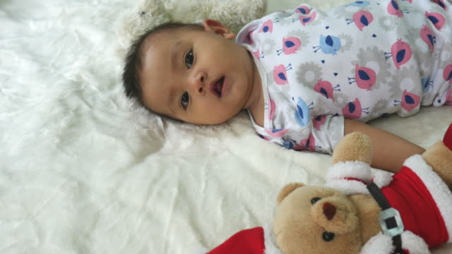 Asian baby smiling with Christmas  toy
