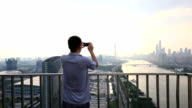Asian Business Man Take Photo of Guangzhou CBD