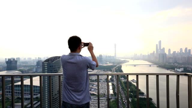 Asian Business Man Take Photo of Guangzhou CBD