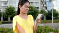 Asian Business Woman on The Phone at Outdoor