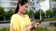 Asian Business Woman Reading with Tablet at Outdoor