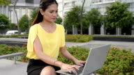 Asian Business Woman with Notebook at Outdoor