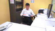 Asian businessman are reading document from files folders