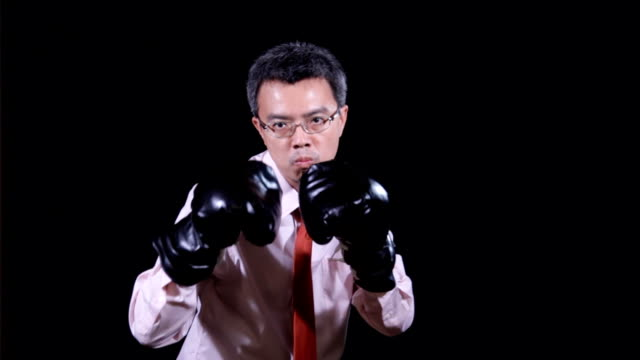 Asian businessman in boxing concept