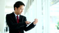 Asian Businessman working on tablet