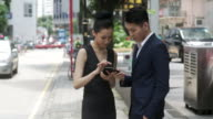 Asian businesspeople with a smartphone