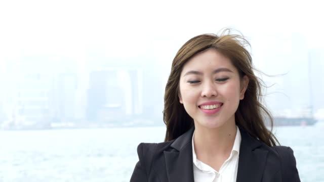 Asian Businesswoman enjoy coffee outdoor in Hongkong.