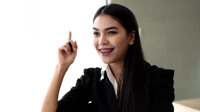 Asian Businesswoman enjoy smiling at camera