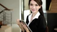 Asian Businesswoman enjoy smiling at camera