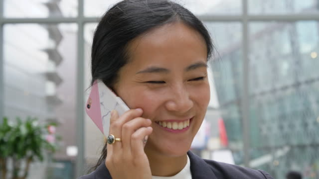 Asian businesswoman talking on mobile phone.