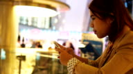 Asian businesswoman touching mobile phone