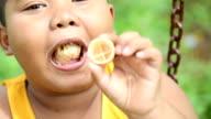 Asian fat boy eating ice-cream, Slow motion
