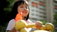 Asian female child playing with water gun