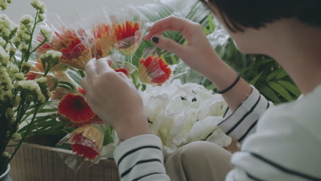 Asian Florists arranging bouquets in flower shop