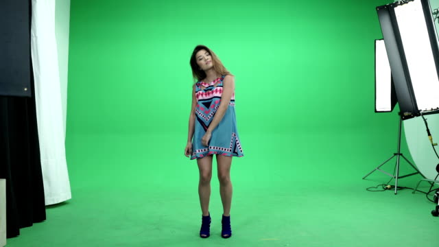 Asian Girl Dancing on Green Background