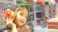 Asian girl having fun shopping gift