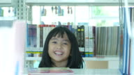 Asian girl playing in library