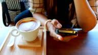 Asian girl using smart phone in restaurant