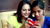 Asian Indian Mother and Daughter playing Games on Smart Phone