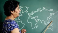 Asian Indian Senior Woman Teacher Teaching Geography