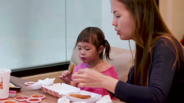 Asian Little Girl Eating French Fries