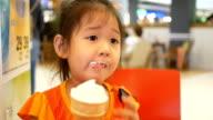 asian little girl eating ice cream