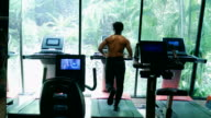 Asian man exercising in Fitness
