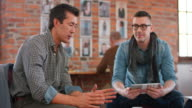 Asian man introducing the project to coworker in meeting