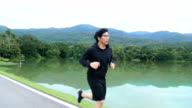Asian man jogging in the morning