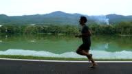 Asian man running on barefoot