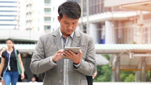 Asian man using a tablet PC