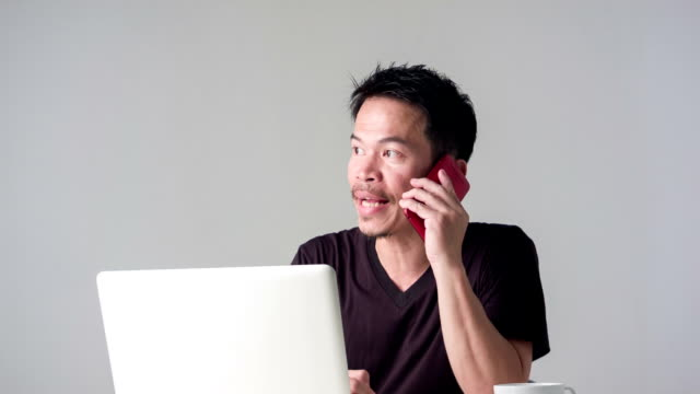 HD DOLLY : Asian man using smart phone