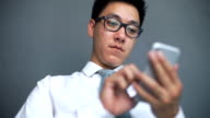 Asian man using smartphone, he is social addict