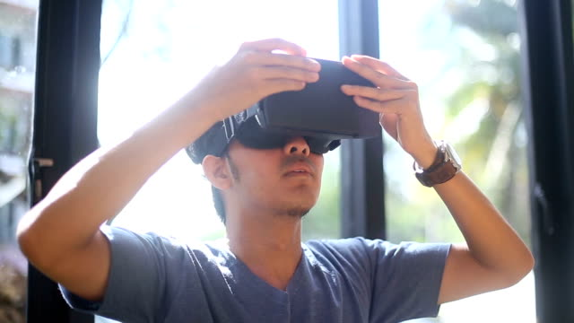 Asian Man using Virtual reality headset