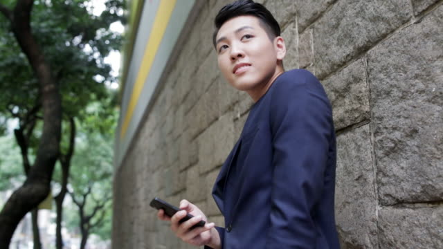 Asian man with smart phone