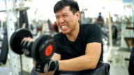 Asian man working out in gym