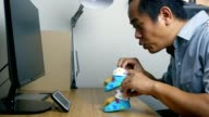 Asian men video call and show baby socks
