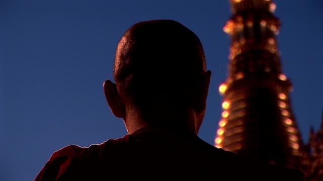Asian monk praying in pagoda