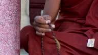 asian monk  praying